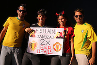 Fans of Belgium with a sign saying Fellanini and Januzaj Manchester United Red devils