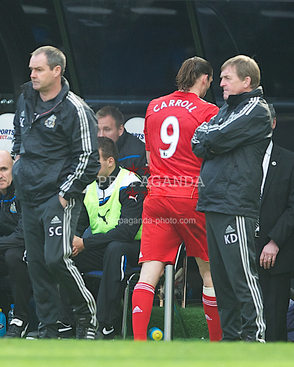 NEWCASTLE-UPON-TYNE, ENGLAND - Sunday, April 1, 2012: Liverpool's Andy Carroll storms past manager Kenny Dalglish as he is substituted during the Premiership match against his former club Newcastle United at St James' Park. (Pic by David Rawcliffe/Propaganda)