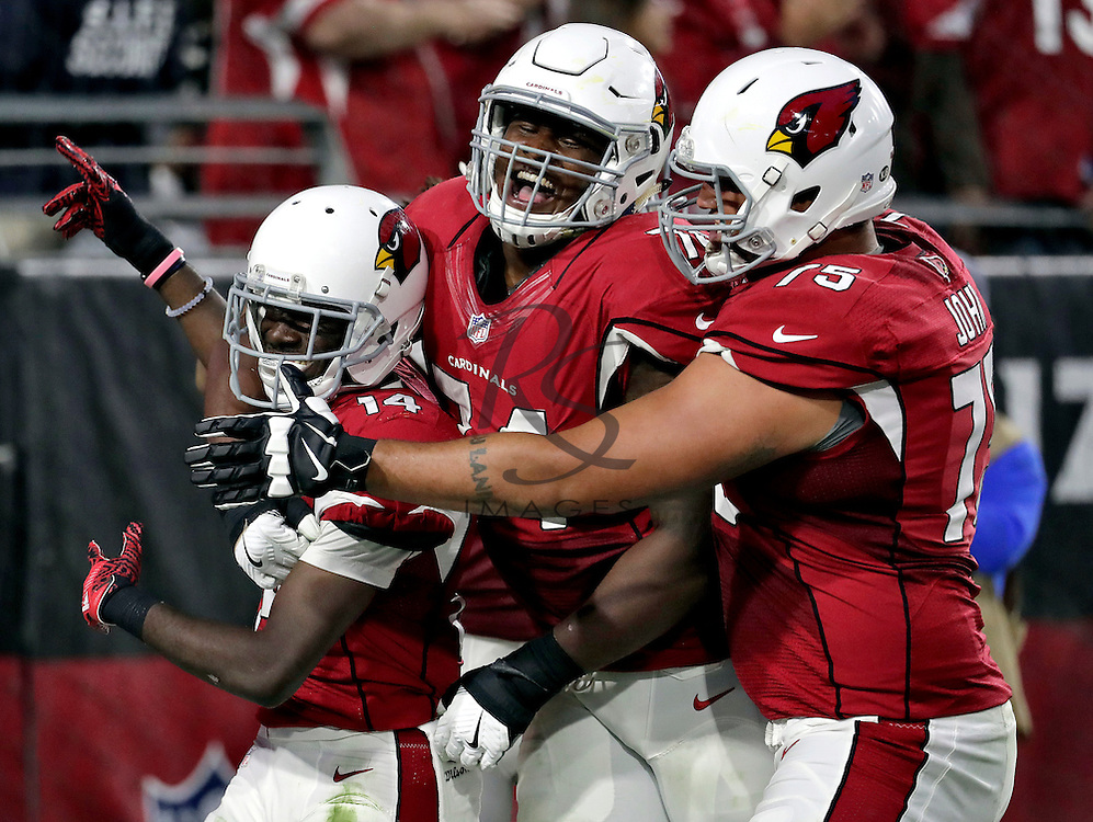 Arizona Cardinals wide receiver J.J. Nelson (14) celebrates his touchdown with tackle Ulrick John (75) and tackle D.J. Humphries (74) during the second half of an NFL football game against the Washington Redskins, Sunday, Dec. 4, 2016, in Glendale, Ariz. (AP Photo/Rick Scuteri)