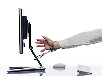 hand chained to computer with handcuffs addiction expression concept isolated studio on white background