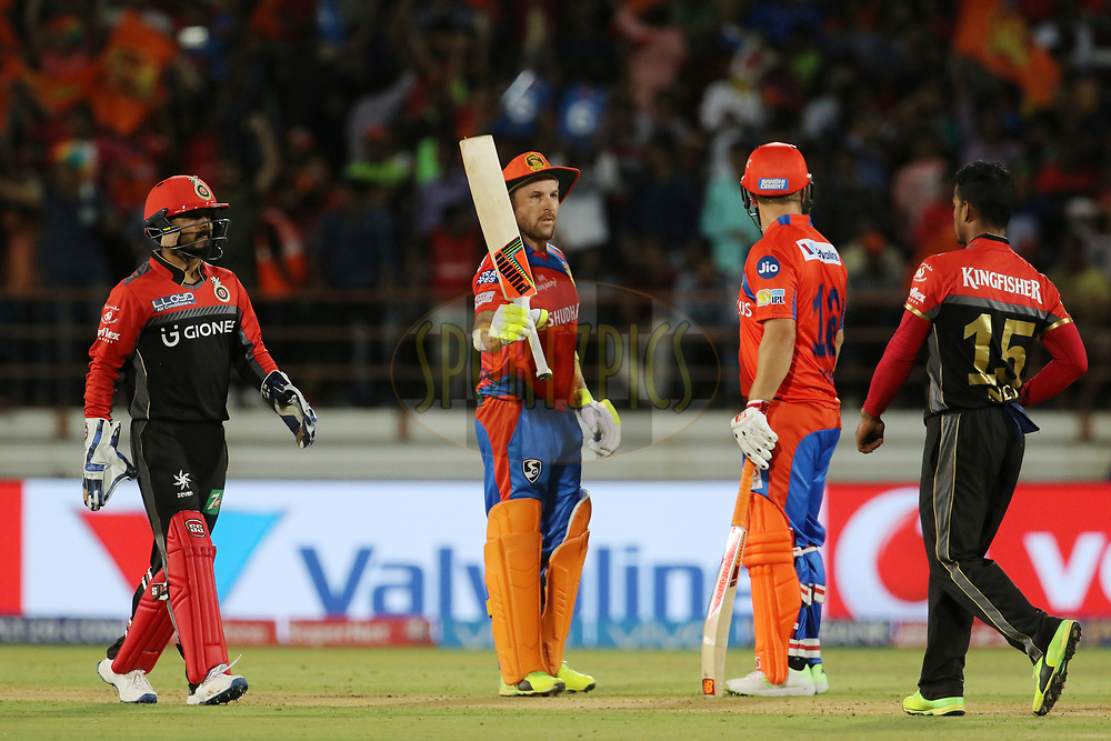 Brendon McCullum of the Gujarat Lions raises his bat after scoring a fifty during match 20 of the Vivo 2017 Indian Premier League between the Gujarat Lions and the Royal Challengers Bangalore  held at the Saurashtra Cricket Association Stadium in Rajkot, India on the 18th April 2017<br /> <br /> Photo by Vipin Pawar - Sportzpics - IPL