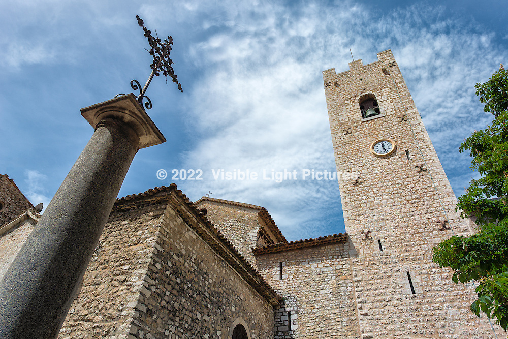 Church bell tower and clock in Vence, France.