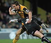 2005/06 Guinness Premiership Rugby, Saracens vs Northampton Saints, Saints David Quinlans, attacking run is counters by the diving tackle from Sarries Kyran Bracken. Vicarage Road, Watford, ENGLAND:     05.11.2005   © Peter Spurrier/Intersport Images - email images@intersport-images..