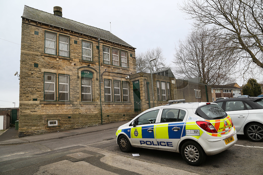 """© Licensed to London News Pictures. 01/04/2016. Dewsbury, UK. A police car parked outside the Tarbiyah Academy in Dewsbury, West Yorkshire, which is under investigation for 'promoting extremism'. The private Islamic school is under investigation after allegations it is teaching an """"extreme form of Islam.  Photo credit : Ian Hinchliffe/LNP"""