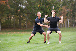 personal trainer working with a client in the park