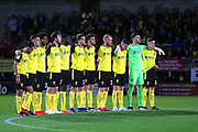 Burton Albion players observe a minutes silence in memory of former player Kelvin Maynard during the EFL Cup match between Burton Albion and Bournemouth at the Pirelli Stadium, Burton upon Trent, England on 25 September 2019.