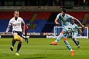 Sunderland striker Ashley Fletcher (9) gets the shot away past Bolton Wanderers defender David Wheater (31) during the EFL Sky Bet Championship match between Bolton Wanderers and Sunderland at the Macron Stadium, Bolton, England on 20 February 2018. Picture by Craig Galloway.