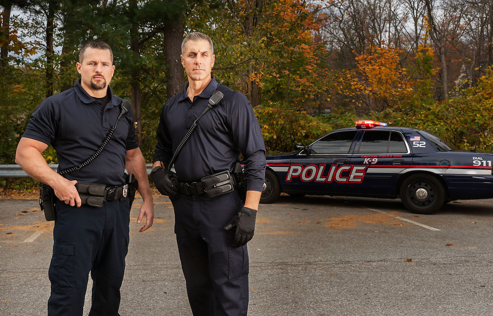 Police officers in front of patrol car