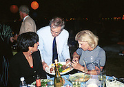 Harry Evans serving fod during Talk magazine launch. New York. 2 September 1999.<br />© Copyright Photograph by Dafydd Jones<br />66 Stockwell Park Rd. London SW9 0DA<br />Tel 0171 733 0108