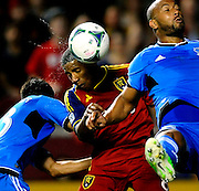 Real Salt Lake's Joao Plato heads the ball in between San Jose' Steven Beitashour, left, and Victor Bernardez during a game at Rio Tinto Stadium on Saturday, September 20, 2013.