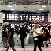May 24, 2016 - New York, NY :  Travelers congregate around the departures board in the Amtrak Concourse on Penn Station's upper level, as they wait for their trains to be assigned a track during the evening rush on Tuesday. Above them, music filters into the space through a series of in-ceiling speakers. CREDIT: Karsten Moran for The New York Times