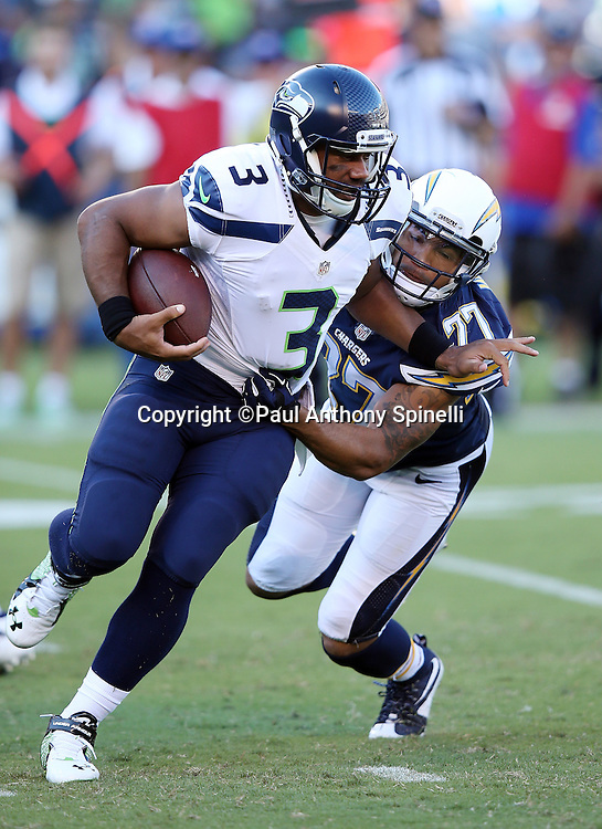 Seattle Seahawks quarterback Russell Wilson (3) gets gets sacked by San Diego Chargers defensive back Jimmy Wilson (27) for a loss of 5 yards in the first quarter during the 2015 NFL preseason football game against the San Diego Chargers on Saturday, Aug. 29, 2015 in San Diego. The Seahawks won the game 16-15. (©Paul Anthony Spinelli)