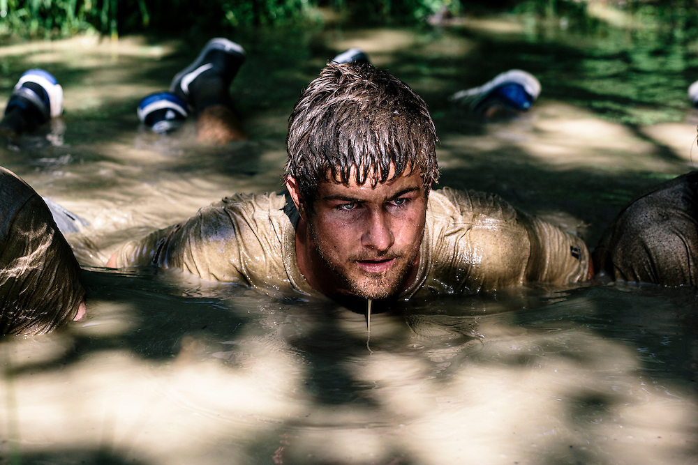 One of the exercises in the mud for the Extreme SEAL Experience included seeing how long participants could stay hidden underneath the surface.