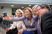 """17 JUL 2014, BERLIN/GERMANY:<br /> Ursula von der Leyen, CDU, Bundesverteidigungsministerin, Julia Kloeckner, CDU, CDU Landesvorsitzende Rheinland-Pfalz, Volker Bouffier, CDU, Ministerpraesident Hessen, Armin Laschet, CDU, CDU Landesvorsitzender NRW, (v.L.n.R.), machen ein Selfie mit dem Smartphone, """"Berliner Gespraech spezial"""" der CDU, anlaesslich des 60. Geburtstags von Angela Merkel, Konrad-Adenauer-Haus<br /> IMAGE: 20140717-01-008<br /> KEYWORDS: Julia Klöckner, Gespräch, Foto, Bild, Mobiltelefon, Handy, Selfy, Selfi"""