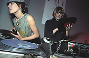 Female DJs Queens of Noize , one holding up a record, UK 2000'S