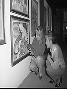 """Pauline Bewick Art Exhibition..1986..03.06.1986..06.03.1986..3rd June 1986..At the Guinness Hop Store,Dublin,artist Pauline Bewick is having an exhibition of her work.The exhibition called """"2 to 50 years""""is a display of her work from age 2 to the present.the art work ranges from simple pencil sketches to more complex paintings and lino cuts...Picture shows the artist,Pauline Bewick,discusses her painting """"Madame Butterfly' with her friend Ms Stam Mintz. Ms Mintz assisted Pauline with the hanging of her work for the exhibition."""