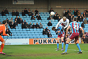 Leon Clarke (9) heads towards goal  during the Sky Bet League 1 match between Scunthorpe United and Bury at Glanford Park, Scunthorpe, England on 19 April 2016. Photo by Ian Lyall.