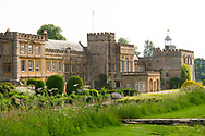 Forde Abbey, a former Cistercian monastery surrounded by lush borders and spring grasses in Chard, Dorset, UK