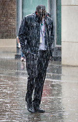 © Licensed to London News Pictures. 10/08/2018. London, UK. A man runs for cover as a sudden rain shower hits Uxbridge. Photo credit: Peter Macdiarmid/LNP