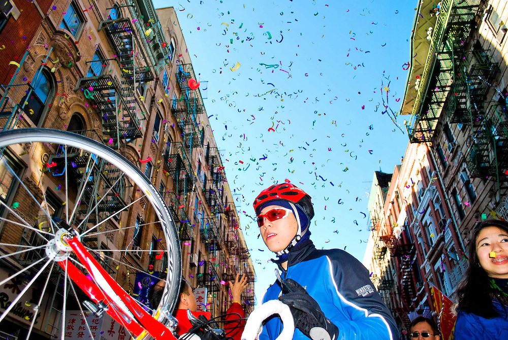 A cyclist making his way through the crowd during Chinese New Year celebrations in New York, 2009