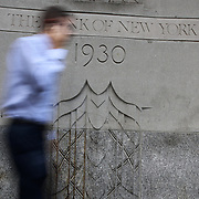 The Bank of New York wall engraving in Wall Street and the New York Stock Exchange, Financial District, Downtown Manhattan, New York City, USA. 16th September 2014. Photo Tim Clayton
