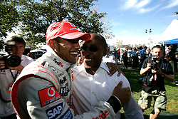 Melbourne. Australia - Sunday, March 18, 2007: Lewis Hamilton (GBR, Vodafone McLaren Mercedes) celebrates his third place finish with his father at the opening Grand Prix of the Formula One World Championship in Australia.(Pic by Michael Kunkel/Propaganda/Hoch Zwei)