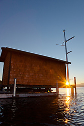 """Tahoe City Pier at Sunrise 4"" - This small building on the end of a pier was photographed at sunrise near Commons Beach, Lake Tahoe. Photographed from a kayak."