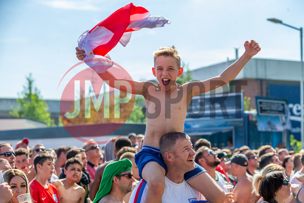 A young fan and his dad enjoy the outside big screen - Ryan Hiscott/JMP - 07/07/2018 - FOOTBALL - Ashton Gate - Bristol, England - Sweden v England, World Cup Quarter Final, World Cup Village at Ashton Gate