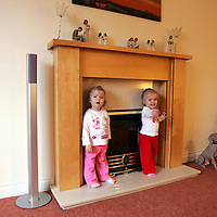 'Right At Home' property feature..25.03.07<br />Paul & Jenny Murray's home at 51 Petrel Way, Dunfermline.<br />Paul and Jenny's twin daughters by the fireplace, Leah (left) and Carrie<br />Picture by Graeme Hart.<br />Copyright Perthshire Picture Agency<br />Tel: 01738 623350  Mobile: 07990 594431