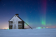 Early on the morning of February 19th, the northern lights made an appearance in Central Illinois. It happened to be one of the few winter nights that was clear and not bitterly cold. There was still plenty of snow on the ground, and the barn was illuminated by a quarter moon. I waited around for many hours, but the aurora was only bright for about 10 minutes. That is how it often happens with mid-latitude auroras.<br /> <br /> Date Taken: February 19, 2014