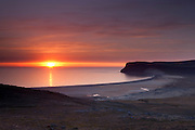 The sun sets over Breiðavik, a small bay that empties into the Altantic Ocean in western Iceland. During the summer, the sun does not set here until after midnight.