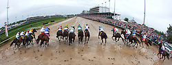 Horses leave the starting gate in the 139th running of the Kentucky Derby May 3, 2013 at Churchill Downs. Photo by Jonathan Palmer