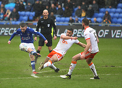 Jack Byrne of Oldham Athletic (L) has a shot at goal - Mandatory by-line: Jack Phillips/JMP - 02/04/2018 - FOOTBALL - Sportsdirect.com Park - Oldham, England - Oldham Athletic v Blackpool - Football League One