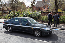© Licensed to London News Pictures . 30/04/2013 . Salford , Greater Manchester , UK . A blue Saab 95 surrounded by police tape on the opposite side of the road . Police and forensic scenes of crime examiners at the scene on Regent Road , Salford , where a prison van was hijacked this morning (Tuesday 30th April) . Police report that two prisoners escaped . Photo credit : Joel Goodman/LNP