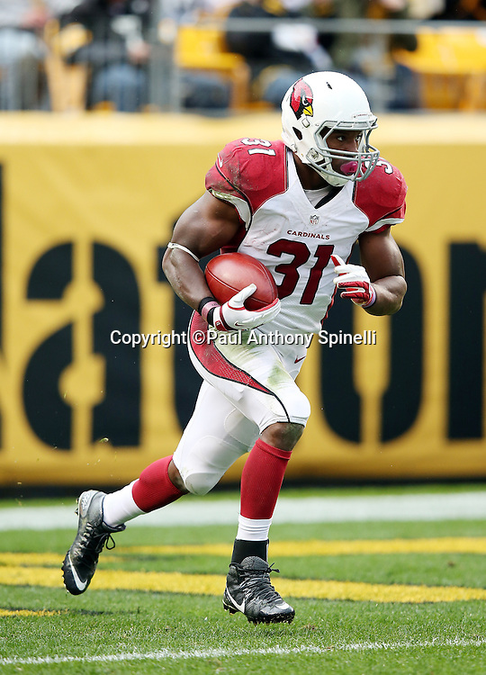 Arizona Cardinals running back David Johnson (31) returns a third quarter kick during the 2015 NFL week 6 regular season football game against the Pittsburgh Steelers on Sunday, Oct. 18, 2015 in Pittsburgh. The Steelers won the game 25-13. (©Paul Anthony Spinelli)