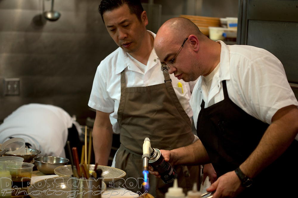Chef Shotaro Kamio, second from right, supervises a dish in the kitchen at Iyasare restaurant, Wednesday, April 2, 2014 in Berkeley, Calif. (Photo by D. Ross Cameron)