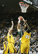 04 JANUARY 2007: Michigan State center Goran Suton (14) drives to the basket between Iowa center Seth Gorney (53) and forward Cyrus Tate (44) in Iowa's 62-60 win over Michigan State at Carver-Hawkeye Arena in Iowa City, Iowa on January 4, 2007.