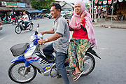 "Sept. 24, 2009 -- PATTANI, THAILAND:  Muslim families on motorcycles in Pattani, Thailand. Thailand's three southern most provinces; Yala, Pattani and Narathiwat are often called ""restive"" and a decades long Muslim insurgency has gained traction recently. Nearly 4,000 people have been killed since 2004. The three southern provinces are under emergency control and there are more than 60,000 Thai military, police and paramilitary militia forces trying to keep the peace battling insurgents who favor car bombs and assassination.   Photo by Jack Kurtz / ZUMA Press"