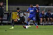 AFC Wimbledon attacker Michael Folivi (17), battles for possession with Brighton and Hove Albion defender Antef Tsoungui (88) during the EFL Trophy (Leasing.com) match between AFC Wimbledon and U23 Brighton and Hove Albion at the Cherry Red Records Stadium, Kingston, England on 3 September 2019.