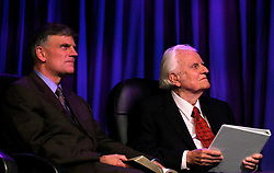 March 12th, 2006. New Orleans, Louisiana. <br /> Claiming this to be his last event preaching from the pulpit, the world's most famous evangelist, The Reverend Billy Graham, his son Franklin to the left prepares to address a capacity crowd at the New Orleans Arena as he brings his 'Celebration of Hope' weekend event to an end.<br /> Photo©; Charlie Varley/varleypix.com
