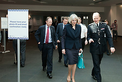 "© Licensed to London News Pictures. 22/05/2012. Manchester, UK. The Home Secretary, Theresa May, talks with Sir Hugh Orde, the chairman of the Association of Chief Police Officers, as she leaves the ACPO conference in Manchester. They walk by a sign that says ""Have your photo ID and email confirmation ready"". Photo credit : Joel Goodman/LNP"