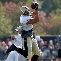 July 29, 2012; Metairie, LA, USA; New Orleans Saints tight end Jimmy Graham (80) makes a catch during a training camp practice at the team's practice facility. Mandatory Credit: Derick E. Hingle-US PRESSWIRE