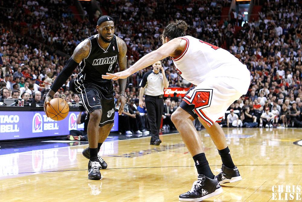 29 January 2012: Chicago Bulls center Joakim Noah (13) defends on Miami Heat small forward LeBron James (6) during the Miami Heat 97-93 victory over the Chicago Bulls at the AmericanAirlines Arena, Miami, Florida, USA.