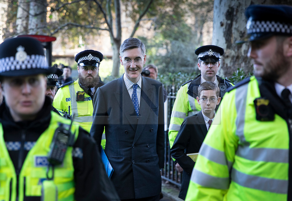 © Licensed to London News Pictures. 19/10/2019. London, UK. Jacob Reese Mogg and his son (R) leave Parliament surrounded by police after MPs voted for a Brexit deal delay. The Prime Minister's new Brexit deal is being debated and voted on in an historic Saturday sitting in The House of commons today. Photo credit: Peter Macdiarmid/LNP