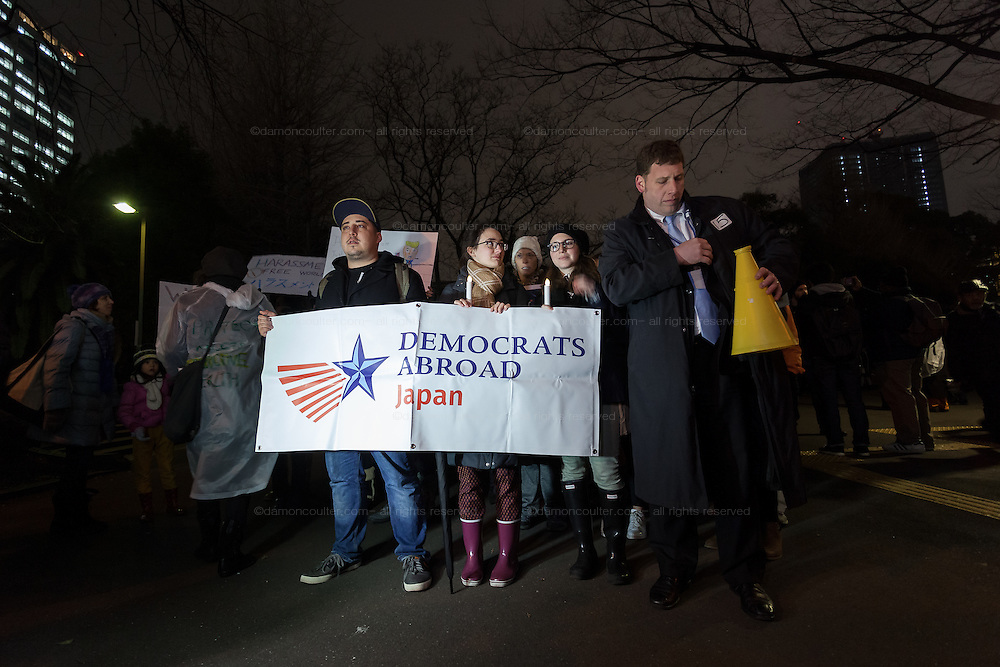 Chairman of the Democrats Abroad Japan organisation, Tom Schmid (right) leads a protest march by members of the Democratic Party Abroad organisation to mark the inauguration of President Donald Trump, Tokyo, Japan. Friday January 20th 2017 Around 400 people took apart in the march, which started in Hibiya Park at 6:30pm and finished in Roppongi just before 8pm, to honour the service given by President Obama and to protest against the illiberal policies expected of the new administration of President  Trump.