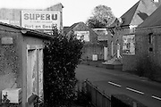 "Colleville sur Mer | Oct 15 2009..An empty road with an advertising table of the french supermarket chain ""Super U"" is seen at the main road in the french village of Colleville sur Mer. Colleville sur Mer was one of the first villages to be freed by Allied Forces entering Europe on June 6, 1944 (D-Day).  ..Photo: juelich/ip-photo.com"