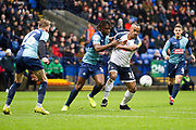 Bolton Wanderers forward Chris O'Grady in a challenge with the opponent during the EFL Sky Bet League 1 match between Bolton Wanderers and Wycombe Wanderers at the University of  Bolton Stadium, Bolton, England on 15 February 2020.