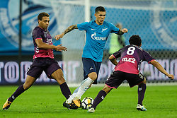 August 24, 2017 - Saint Petersburg, Russia - Leandro Paredes (C) of FC Zenit Saint Petersburg vies for the ball with Cyriel Dessers (L) of FC Utrecht and Yassin Ayoub of FC Utrecht during the UEFA Europa League play-off round second leg match between FC Zenit St. Petersburg and FC Utrecht at Saint Petersburg Stadium on August 24, 2017 in Saint Petersburg, Russia. (Credit Image: © Mike Kireev/NurPhoto via ZUMA Press)