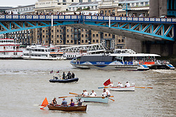 © Licensed to London News Pictures. 03/09/2016. Hundreds of craft have been rowed up the Thames from Millwall on the Isle of Dogs to Ham, Richmond in the annual Great River Race.  London's river marathon is 21 miles long and was started in 1988. Credit: Rob Powell/LNP
