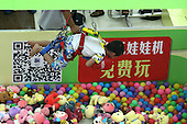 Human Claw Machine Opens At Chongqing Shopping Mall